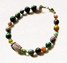 Maggies Beadery 8 1/2 inch womens Fancy Jasper bracelet which closes with a sterling silver lobster clasp. A matching 18 1/4 inch necklace with a pendant is available.