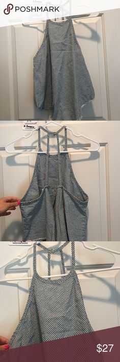Urban Outfitters Top Blue and white stripes with little fringe on the bottom. Perfect for the summer or the 4th of July! A tank top that buttons on the back and is open on the back as well. Never worn and size small. BDG Tops Tank Tops