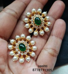 Gorgeous silver ear tops with gold polish. Gold ear tops studded with polki and emeralds. 29 July 2019