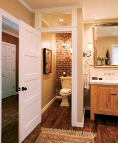 Toilet closet with wood floors, brick wall and glass panel at the top of the door.(I'm going to have a toilet closet,and I really like this). Bathroom Renos, Laundry In Bathroom, Brick Bathroom, Bathroom Wall, Bathroom Vanities, Budget Bathroom, Modern Bathroom, Bathroom With Closet, Bathroom Hacks