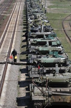 Ukrainian tanks are placed on freight cars before their departure from Crimea to other regions of Ukraine in the settlement of Gvardeiskoye near the Crimean city of Simferopol March 31, 2014. Russia is withdrawing a motorized infantry battalion from a region near Ukraine's eastern border, the Russian Defence Ministry was quoted as saying by state news agencies on Monday. The United States says progress on resolving the East-West stand-off over Ukraine depends on Russia pulling back troops…