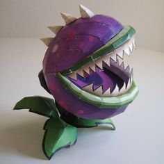 This paper toy is the Chomper, a multi-use instant kill plant, based on the video game Plants vs. Zombie Halloween Decorations, Zombie Crafts, Birthday Decorations, Zombie Birthday Parties, Zombie Party, 5th Birthday, Plants Vs Zombies, Paper Toys, Paper Crafts