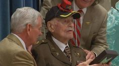 """Students at a school in Mobile, Alabama, helped a World War II veteran celebrate his 106th birthday this week with a surprise party.  As he entered the auditorium of St. Paul's Episcopal School, Major John Jacobson -- known as """"Mr. Jack"""" to most -- received a standing ovation, television station WALA in Mobile reported Wednesday."""