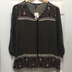 CLOSING❗️NWT Forever 21 Black Print Top Black print blouse with floral accents. New with tags. Tie at neck. Elastic at wrist openings. Tunic/peasant blouse feel. 100% rayon. Size Medium. Forever 21 Tops Blouses
