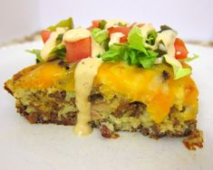 Crowd Pleasing Cheeseburger Pie is super easy to make, a delicious weeknight meal! Made with fresh ingredients and topped with your favorite burger fixings.