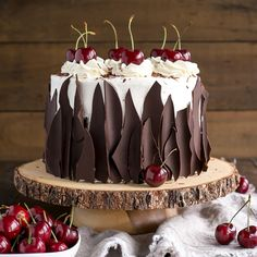 This Black Forest Cake combines rich chocolate cake layers with fresh cherries, cherry liqueur, and a simple whipped cream frosting.