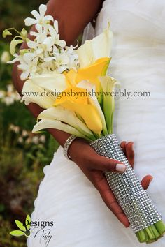 #DesignsByNishy - #bridal #bouquet made from white and yellow cala lilies and white dendrobium orchids. www.designsbynishy.weebly.com