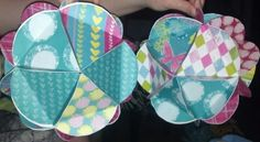 Scrapbook paper to make these colorful paper balls for party or room decor :-)