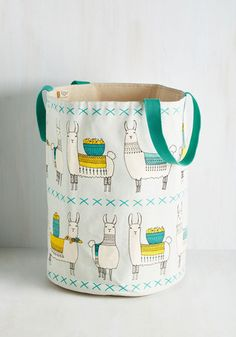 Turn a return to your flat into a true treat by introducing this cotton hamper to your daily routine! Featuring cloth handles and a darling llama print in cream and yellow hues, this sky blue container assures you always have a cute reason to hoof it home!