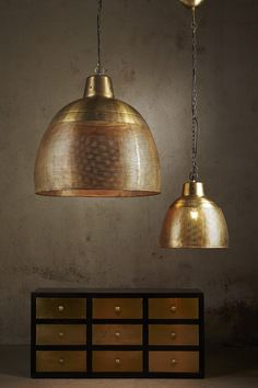 A brass perforated pendant light with an antique gold appearance . This pendant…