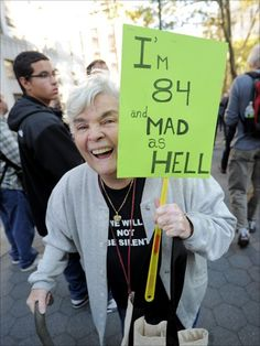 protester.  no idea and dont wanna know.   But notice how her sign was made. great idea for kids in parades!