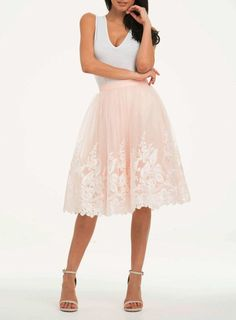 This blush tulle bridesmaid skirt channels vintage wedding style and can be worn again and again.