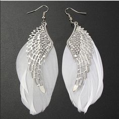 Angel Wing Earrings✨6 available✨ Pretty silver toned zinc alloy earrings with white feathers. New in package. Size and shape of feathers may vary slightly die to them being real feathers. Jewelry Earrings