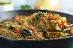 One Pot Greek Eggplant and Rice - An easy to make baked casserole topped with mizithra cheese.