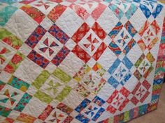 HANDMADE Lap Quilt in Tradewinds by Moda, Scrappy Quilt, Ready to Ship, One of a Kind, Throw Quilt, Sofa Quilt. $260.00, via Etsy.