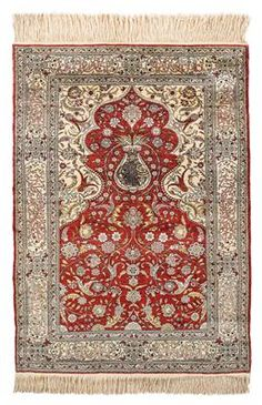 Hereke silk,Northwest Anatolia (Turkey), c. 152 x 108 cm, about 1980, prayer rug with inscription border, c. 1 mill. kts/sqm, partly executed with embedded metal threads, signed, good condition. (MA)