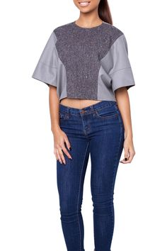 Over sized wool cropped blouse featuring a tweed accent panel. Style with either jeans or a pencil skirt for a more dressed up look.   Grey Crop Top by YSL. Clothing - Tops - Short Sleeve Clothing - Tops - Crop Tops Florida
