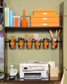 If you're looking to maximize desk space -- and you're feeling crafty -- craft this Suspended Utensil Organizer from paint cans.
