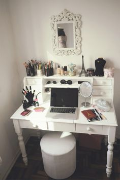 This is a great desk, white painted wood.  Pictured here as a vanity table