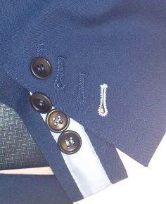 It's all in the detail Working Cuffs (Buttonholes that work) Flash Cuff (This means showing some lining fabric when opened normally in an alternate colour) Horn Buttons (Normally made from actual animal horn/ antlers and not plastic which you get on an off the peg suit) Hand sewn buttonholes (Not machine sewn) Coloured buttonholes (All buttonholes can be sewn in a different colour if required) For this kind of personalisation in your next suit/ coat contact us here at Tailors Row