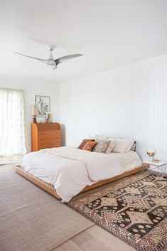 a designer's earthy mid-century remodel. It's always a treat to see inside the home of an interior designer. Oftentimes style is mixed with utilitarianism in an effortlessly cool way. Home Bedroom, Modern Bedroom, Bedroom Decor, Bedroom Ideas, Bedroom Designs, Bedrooms, Minimalist Bedroom Boho, Minimalist Home Design, Minimalist Bed Frame