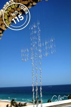 Fabulous Idea No.115: Crystals hung by monofilament create a cross that seems to hang in mid air.