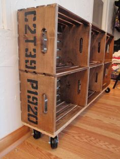 """vintage"" crates made from ""new"" crates, stained, stenciled and adding caster wheels...great idea for storage of books, toys, etc."