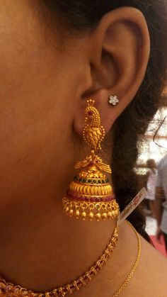 Peacock model ear rings.. weight 2.9gms beautifully arranged stones and more of gold