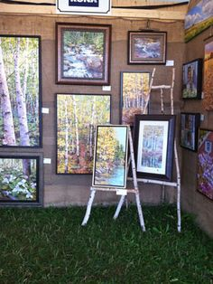 Ideas for setting up an art show booth -- this one, an outdoor show, used a great idea .... easels made of tree limbs.  Great visual in sync with the venue.