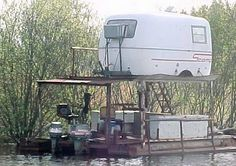 Hillbilly Scamp,  Rita this solves living, boating and travel.....could be worked out. Jan LOL