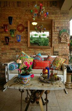 I love this room, especially the colors against the bricks.