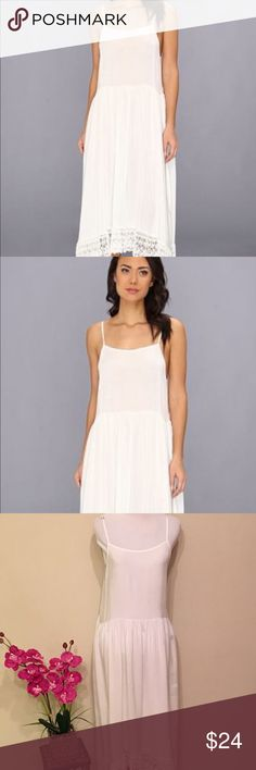 """Free People Easy Breezy Crochet hem slip dress White dress, size SP, hem is asymmetrical. Adjustable straps. Measurements are approximately Length 40 1/2"""", chest 17"""", shoulder opening 10 1/2"""".  No stains, no flaws or defects. In excellent used condition. Free People Dresses Asymmetrical"""