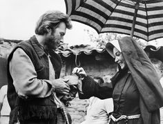 "Love this shot of Clint Eastwood and Shirley McLain on the set of ""Two Mules for Sister Sara"" in 1970."