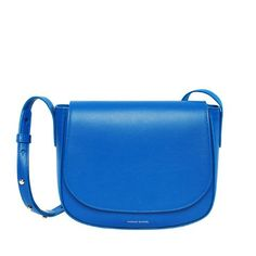 The Mansur Gavriel Royal Crossbody Bag is a rich bright blue crossbody bag with matching color interior. Made of leather it features a magnetic closure and adjustable strap. - Materials: Italian veget