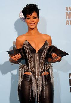 Singer Rihanna poses with the awards for Favorite Female Artist in the categories of Pop/Rock and Soul Rhythm and Blues Music in the press room during the 2008 American Music Awards held at Nokia Theatre L.A. LIVE on November 23, 2008 in Los Angeles, California.