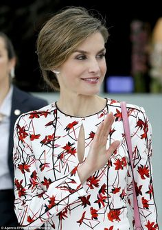 Queen Letizia waves as she leaves the 7th ECToH Conference on Tobacco or Health