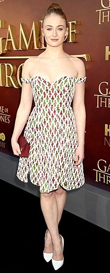 The actress who plays Sansa Stark worked an effervescent, off-the-shoulder Chalayan dress. White pumps, a maroon clutch, and hoop earrings completed the ensemble.
