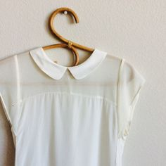 Zara collared blouse Off white sheer too. Loose and flowy. There is one back button. Please refer to last picture.  The back is longer than the front as you can see in the picture.                                                      main fabric: 100% polyester.                               secondary fabric: 100% mulberry silk Zara Tops Blouses