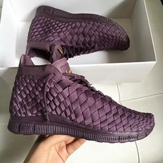 Nike shoes in a dark maroon color. Practically, plum. Ankle shoes, cute for an instagram baddie outfit with tights.