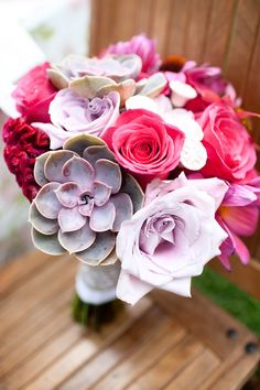 Rose bridal bouquet featuring succulents and cockscomb celosia.