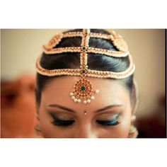 The traditional jewels-Chandra Surya- a full circle depicting the sun and a half circle depicting the moon are make up the  bride's pretty head-gear