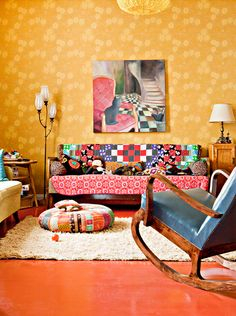 The painting is what makes and coordinates the colors for this room...very happy space...Bright, eclectic and fun. Gorgeous boho living space.