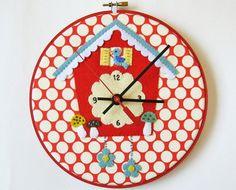 Felt cuckoo clock in embroidery hoop