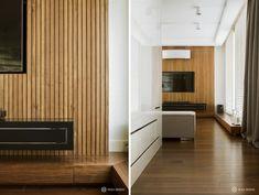 ściana TV na tle drewnianej boazerii