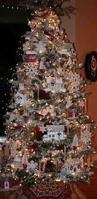 pretty Christmas tree with cottages and snowflakes