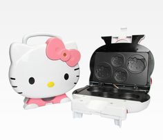 Hello Kitty Cupcake Maker.... Hello Kitty's Face is imprinted on top of the cupcakes!!!