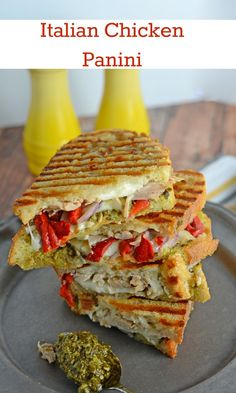 Italian Chicken Panini Recipe - Crusty bread filled with gooey mozzarella cheese, roasted red pepper, shredded chicken and lots and lots of garlicky pesto. http://www.savoryexperiments.com