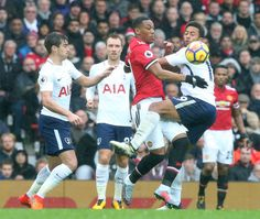 Anthony Martial of Manchester United in action with Mousa Dembele of Tottenham Hotspur during the Premier League match between Manchester United and...