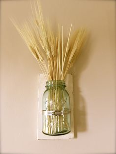 A personal favorite from my Etsy shop https://www.etsy.com/listing/245859760/mason-jar-wall-vase-distressed-wall