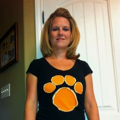 Home made paw print shirt... Just cut out paw print & use a q-tip to dab bleach around the edges... Wore with an Orange tank underneath